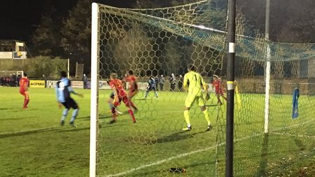 Needham Market keeper Jake Jessop protects his goal during Tuesday night's 3-0 win at St Neots Town.