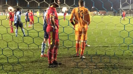 James Baker (red shirt) in the St Neots penalty area. He netted an early goal for Needham Market. Pi