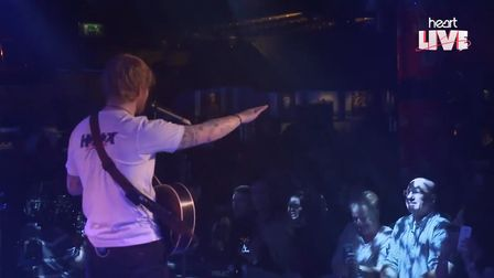 Ed Sheeran stops playing at a secret live gig for Heart FM as a man in the audience proposes to his