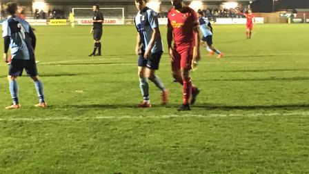 Adam Baker (red shirt), is closely marked ay St Neots Town on Tuesday night, although he did score a