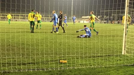 Goalmouth action as Christy Finch, grounded, rues a missed chance at Hitchin Town. Picture: CARL MAR