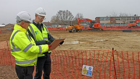 Stowmarket High headteacher Dave Lee-Allan and project manager Kevin Dyke at the site of the new bui