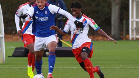 Ben Folami battles for the ball during the 5-2 win over Palace. Picture: ROSS HALLS