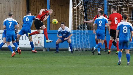 Conner Hubble heads Coggeshall Town into a 2-1 lead as Bury Town again fail to defend a corner. Pict