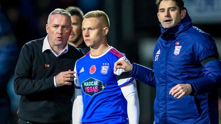 Paul Lambert and his assistant Stuart Taylor prepare to bring substitute Danny Rowe into the game. P