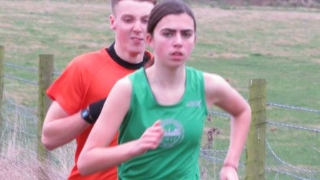Milly Presland, of Colchester Harriers, setting a good pace in the juniro race at the NESS League me