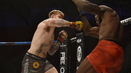 James Webb lands a right hand on Jason Radcliffe on his way to victory at Cage Warriors 99 in Colche