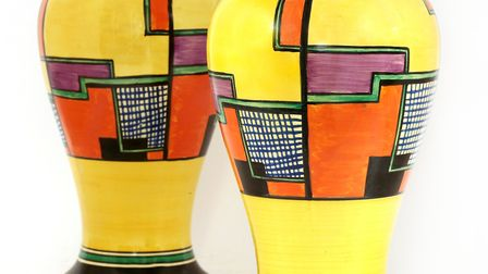 A pair of Clarice Cliff vases in the so-called Football pattern are expected to sell for £2000-3000.