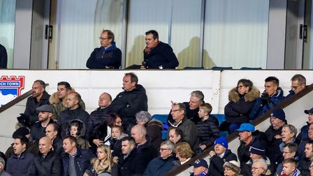 Jonas Knudsen sitting on the back row of the directors box (second right), in front of a watching Ma