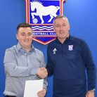 Ipswich Town manager Paul Lambert hands over his letter to the club's supporters to football reporte