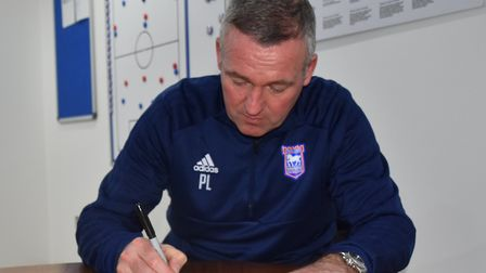 Ipswich Town manager Paul Lambert signs his open letter to the club's supporters, thanking them for