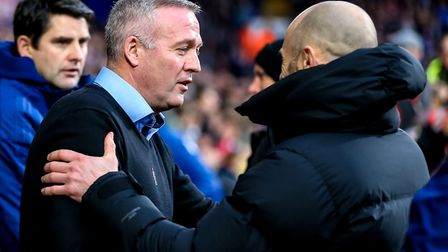 Town manager Paul Lambert greets Rotherham United manager Paul Warne ahead of the match. Picture: