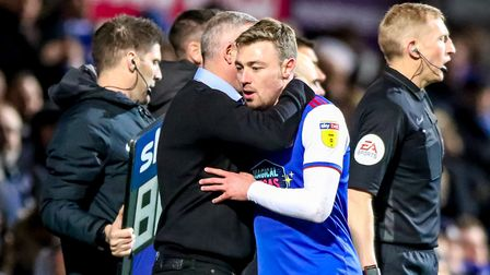 A hug for Freddie Sears from Town manager Paul Lambert when being substituted. Picture: STEVE WAL