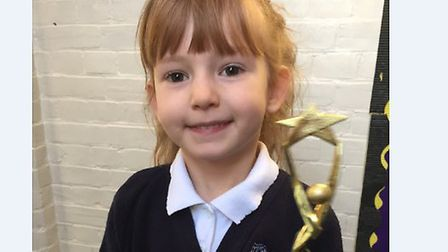 Scarlett Neill has been presented with a special award after her swift action when her mum fell down
