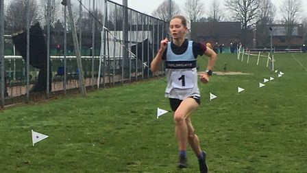 Philippa Unthank, on her way to victory in the senior girls' event at Woodbridge School