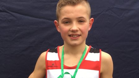 Lewis Sullivan, with his winner's medal after surging to the junior boys' title