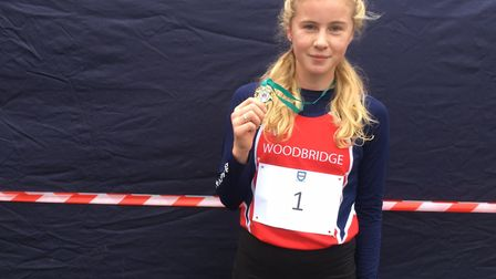 April Hill, with her medal after winning the intermediate girls' race