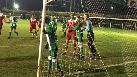 Whitton United are forced to defend their penalty area during the early stages against Godmanchester