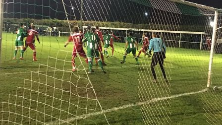 Whitton United are on the defensive as leaders Godmanchester Rovers pile on the pressure. Picture: C