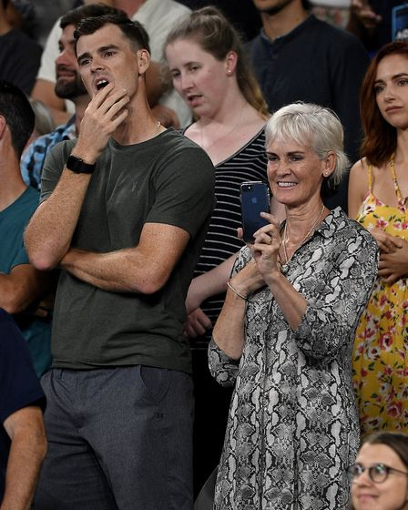 Brother Jamie and mum Judy watch Andy Murray play in Australia. Picture: PA SPORT