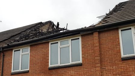 The roof of the property and the interior is black with smoke damage Picture: RACHEL EDGE