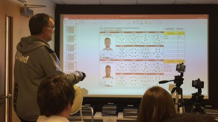 Leeds United manager Marcelo Bielsa gives a PowerPoint presentation to the media during a press conf