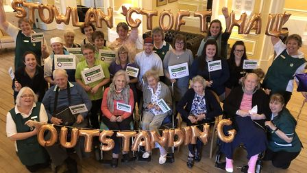 Staff and residents at Stowlangtoft Hall, near Bury St Edmunds, celebrate their 'outstanding' CQC ra