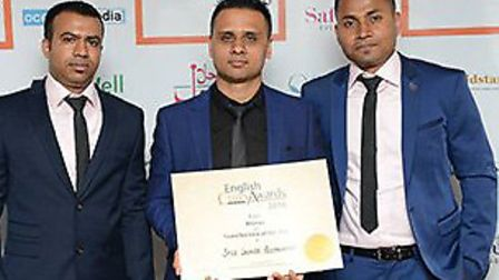 Mr Jueb Alli and the Spice Lounge in Mildenhall with an award Picture: SPICE LOUNGE