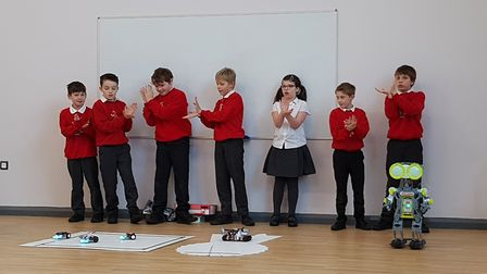 The robots and students dancing at Otley Primary School Picture: RACHEL EDGE