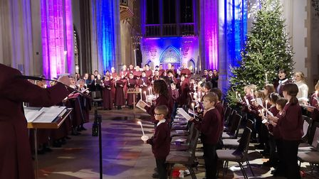 The carols by candlelight service at St Edmundsbury Cathedral raised money for The Children's Societ