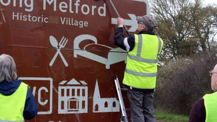 Volunteers in Long Melford cleaned signs earlier in the year as a result of concerns Picture: JOHN N