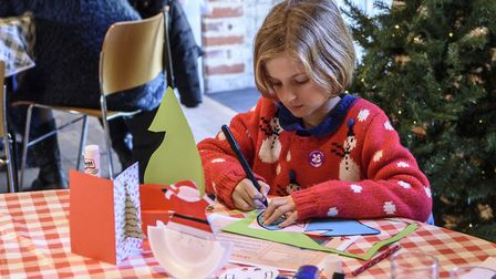 Girl making Christmas crafts at Ickworth House Photo: Jim Woolf