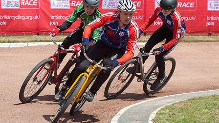 Ipswich's Pierce Bacon leads Max Evans (Astley and Tyldesley) and Ben Clarke (Ipswich). Cycle speedw