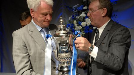 Sir Bobby Robson and Kevin Beattie with the replica FA Cup, at a celebratory dinner several years af