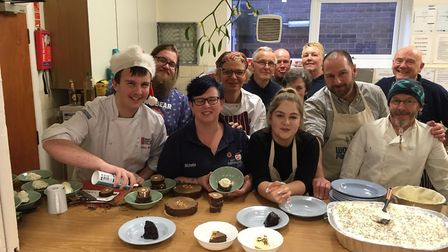 Michelle Frost, second left at the front, and the kitchen volunteers and staff at the Jam Community
