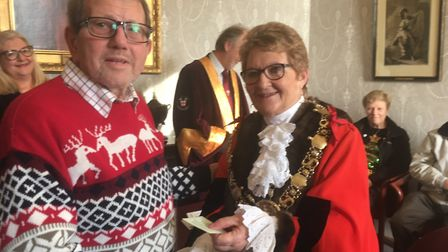 Philip Stevens receives a voucher from Sudbury mayor Sue Ayres at the traditional Christmas Day Gift