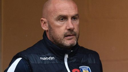 U's boss John McGreal aims to get the better of Morecambe. Picture: RICHARD BLAXALL