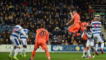 Matthew Pennington with a another first half header on goal at QPR Picture Pagepix
