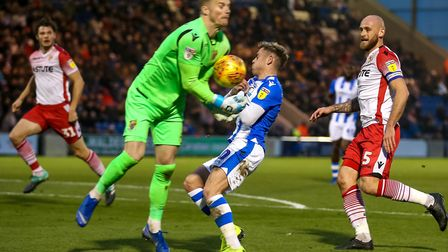 Stevenage keeper Paul Farman just beats a fast-approaching Sammie Szmodics to the ball, during today