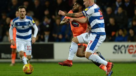 Ellis Harrison loses out in a clash with QPR Captain Toni Leistner Picture Pagepix