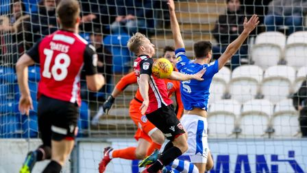 Luke Prosser gets a push from Rhys Oates, who went on to shoot wide in this action from the first ha