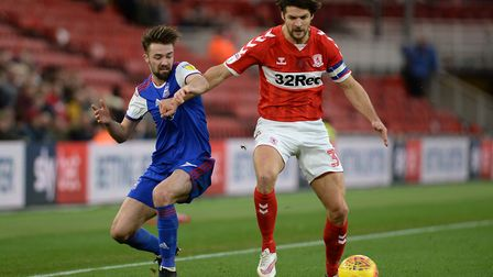 Gwion Edwards is held off by George Friend at The Riverside against Middlesbrough Picture Pagepix