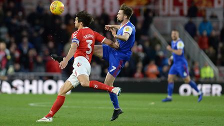 Gwion Edwards high-kicking ahead of George Friend at The Riverside against Middlesbrough Picture Pag