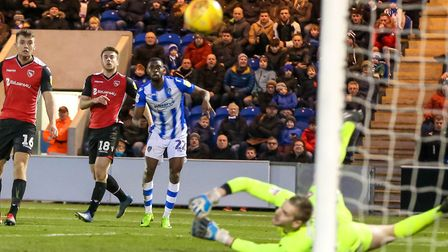 Kane Vincent-Young watches as his well struck effort is saved by Morecambe keeper Mark Halstead earl
