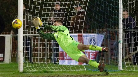 Royston's Joe Welch saves Jake Reed's penalty for Leiston. Picture: PAUL VOLLER