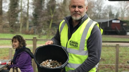 Jason Alexander, founder of Rubbish Walks showing a full bucket of cigarette butts Picture: Victoria