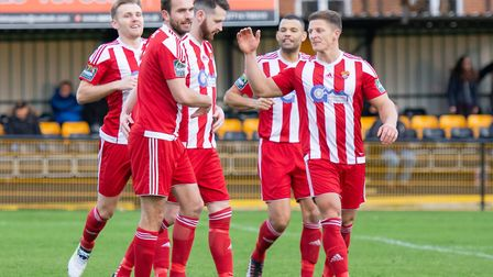 Miles Powell (centre) celebrates after opening the scoring in the sixth minute for Felixstowe in the