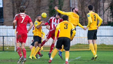 Seasiders captain Rhys Barber (red, centre) equalises with a header in a crowded penalty area just