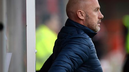 Colchester United boss John McGreal looks on as side lose 2-0 at 10-man Crawley Town on New Year's D