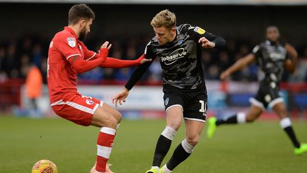 Sammie Szmodics takes on the Crawley defence during the disappointing 2-0 defeat at Broadfield Stadi